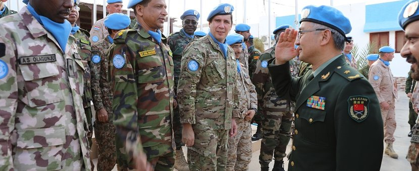 MINURSO Force Commander greeting a military parade at the mission HQ